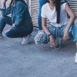 2 women wearing jeans
