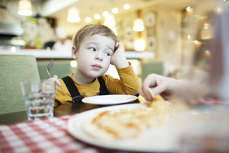 bored child at restaurant