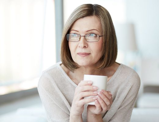 Calm Mature Woman With Cup