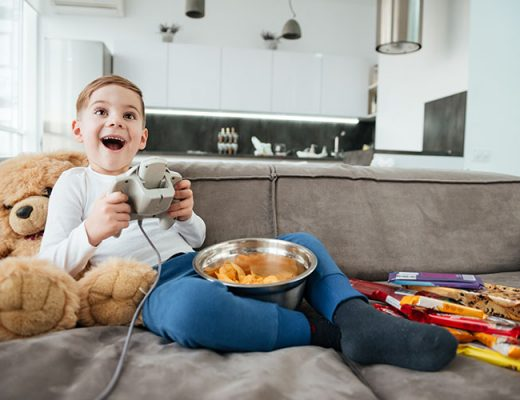 cheerful boy playing video game