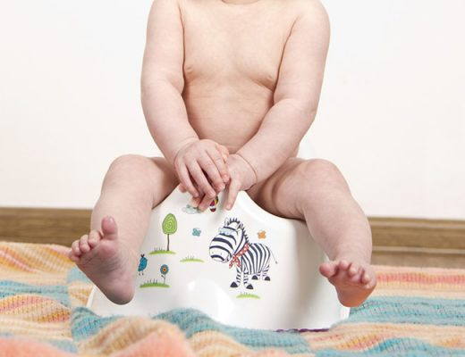 child sitting potty training