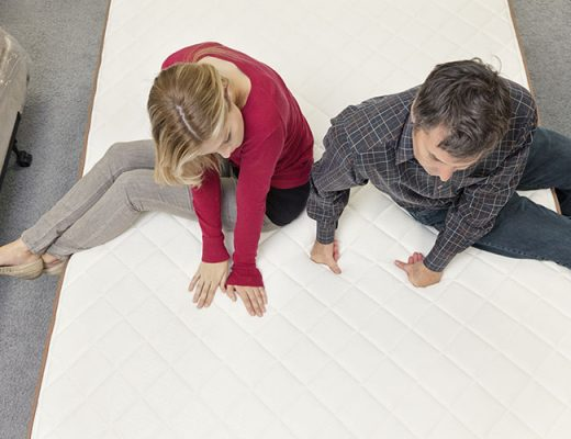 couple testing a mattress