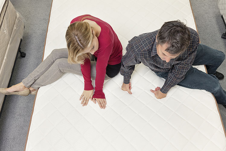 couple testing a mattress