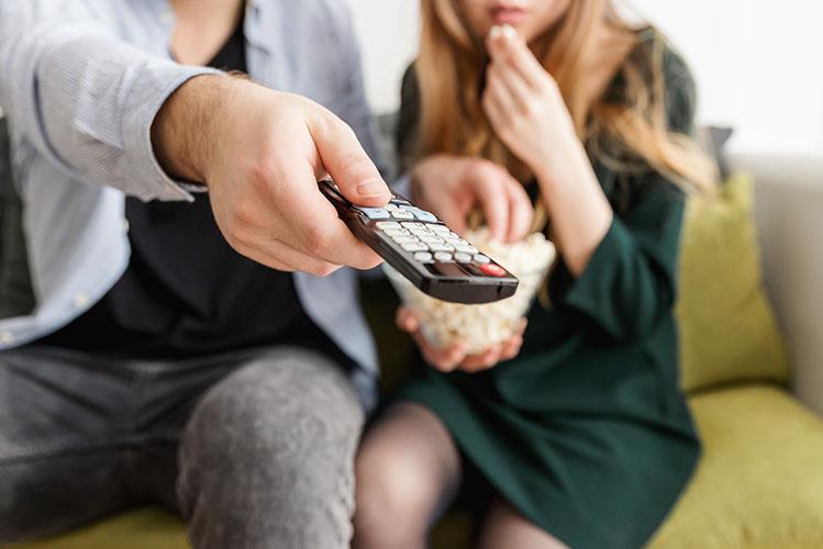 couple using tv remote