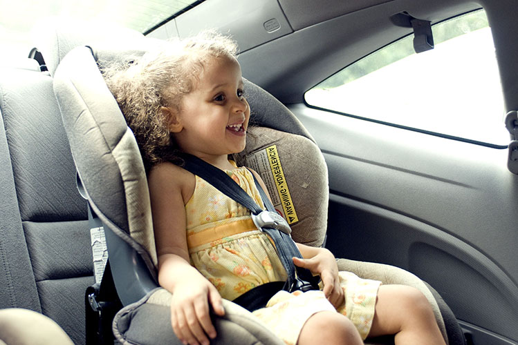 girl child in car seat