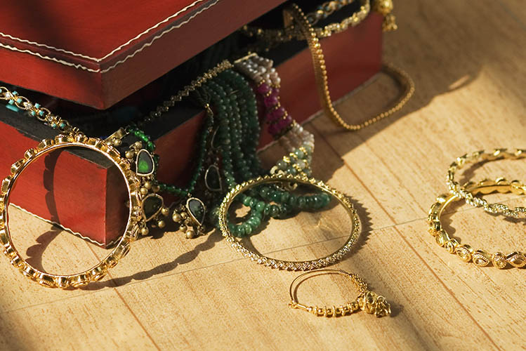 gold bracelets near jewelry box