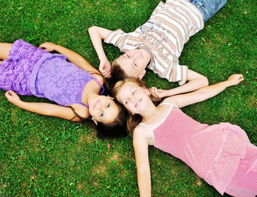 happy kids on the grass outside