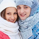 happy young woman and her boyfriend in winter