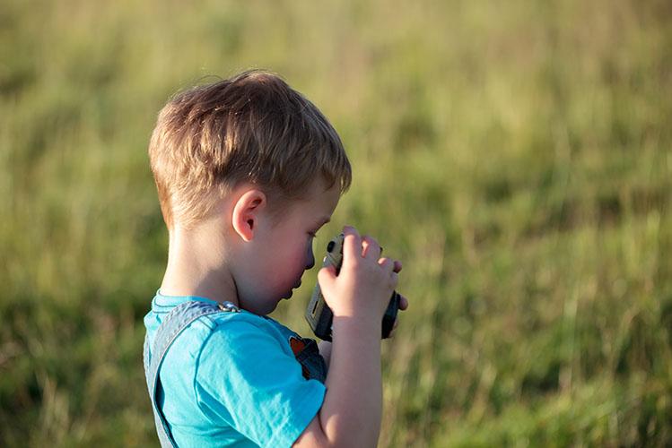 kid taking photos with digital camera