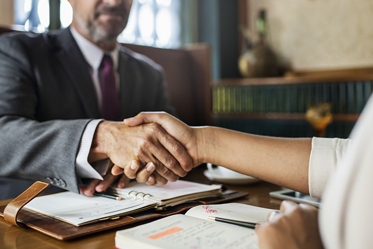 lawyer shaking hands with client