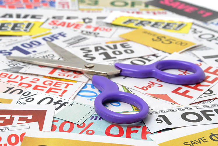 lot of sale coupons on a table