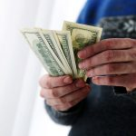 male hands holding US dollars
