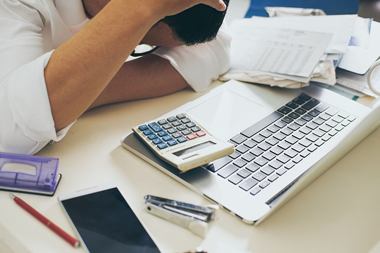 Man counting using calculator and stress in problem with expenses