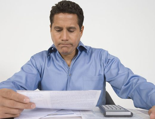 Man reading financial document