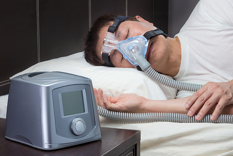 man sleeping with a cpap mask on face