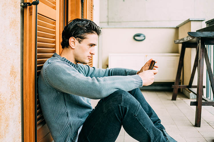 man using smartphone for chatting