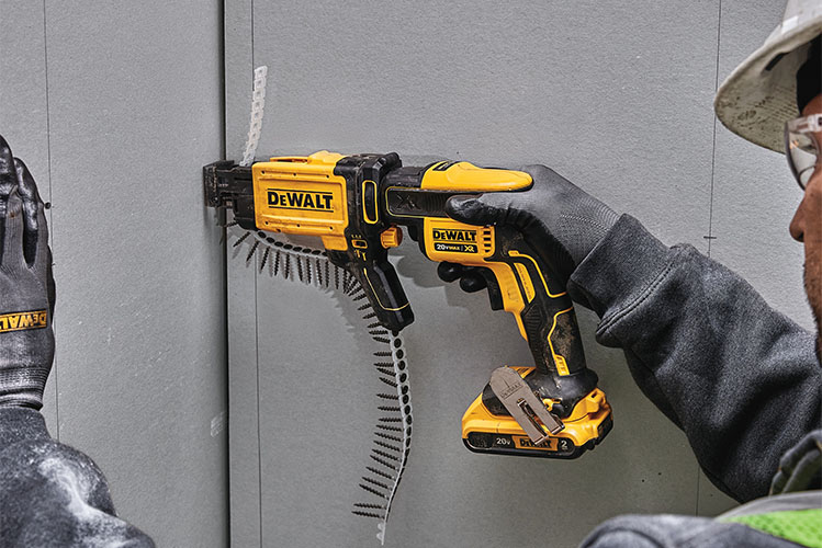 man working with a drywall screw gun