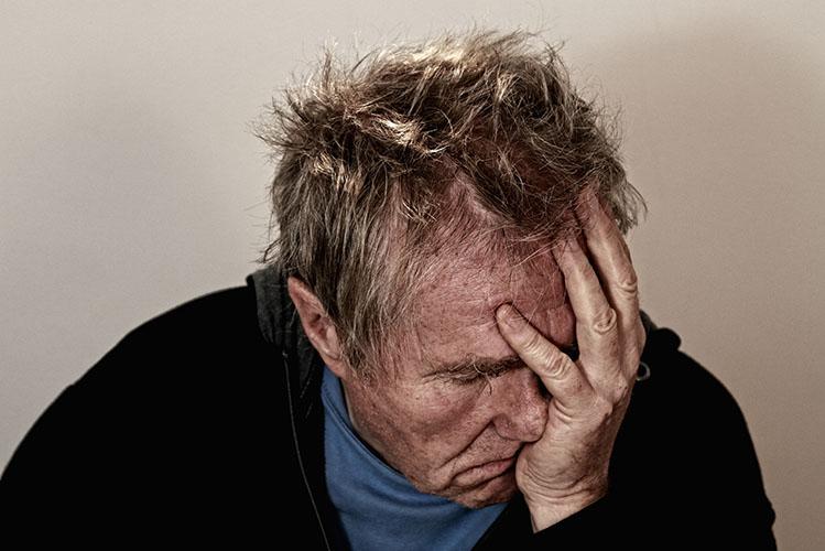 old man having a headache