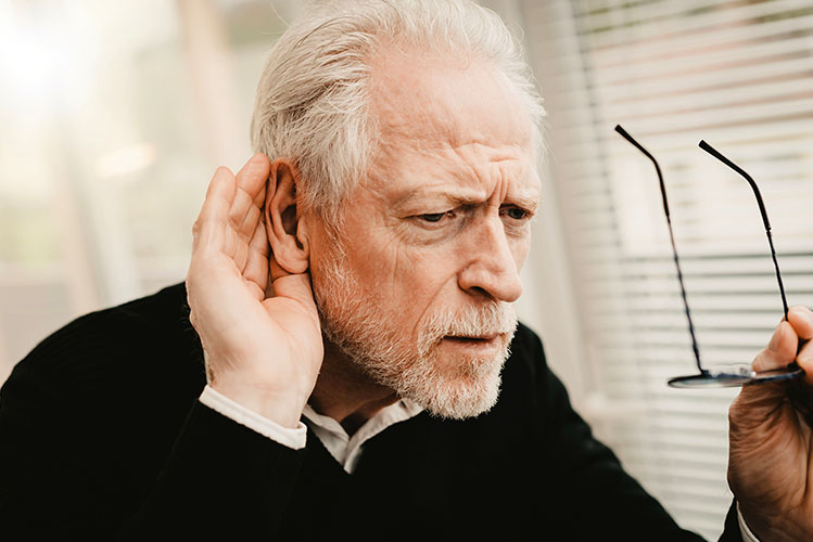 old man trying to hear something