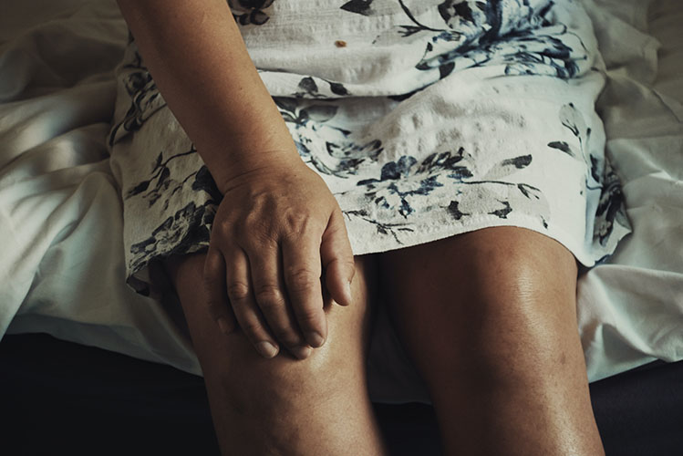old woman suffering from knee pain