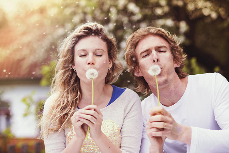 outdoor portrait of young happy couple