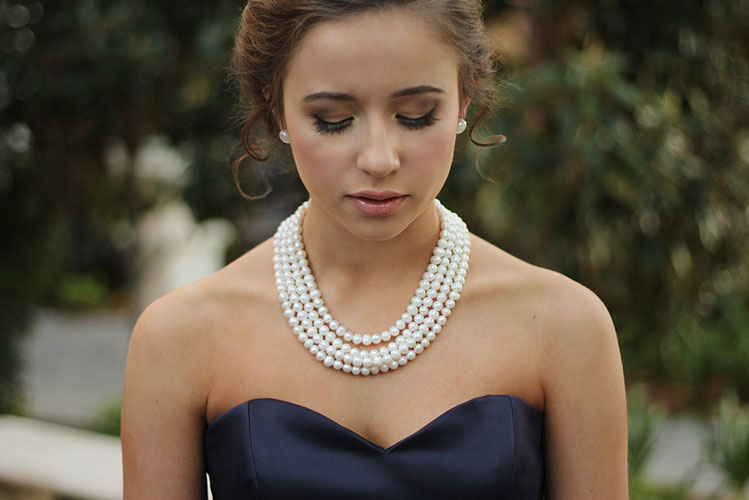 pearl necklace and blue dress