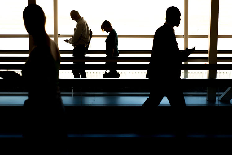 people silhouettes at the airport