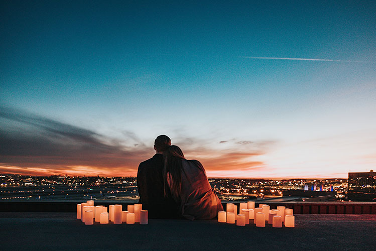 romantic couple sunset candles