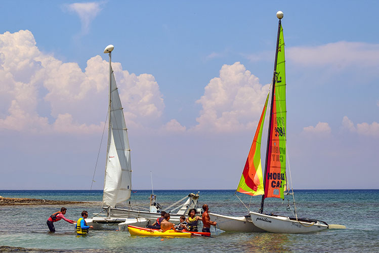sailboats people shore