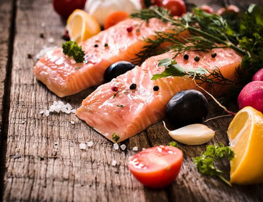 salmon fillets on wooden table