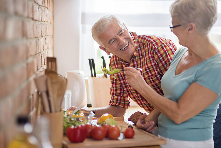 senior couple cooking together healthy meal
