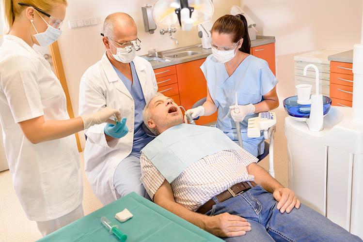 Senior man at dentist having teeth checkup