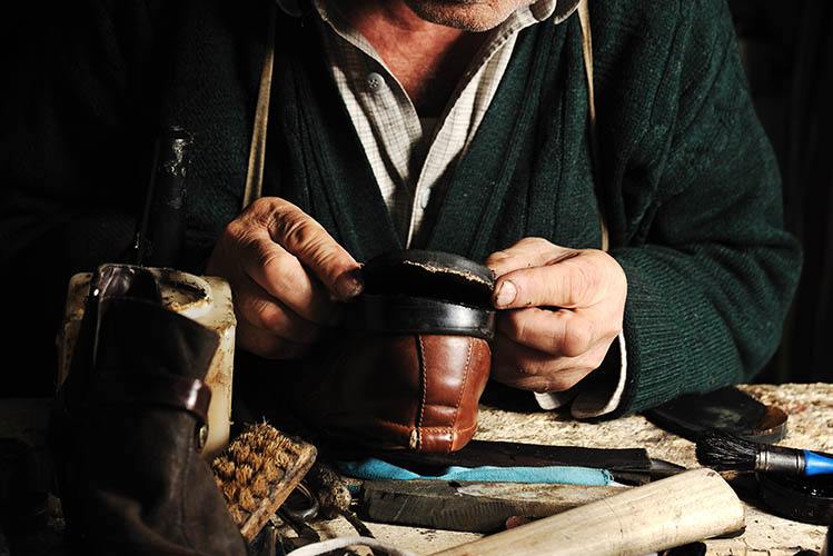 shoemaker repairing old shoes