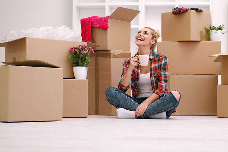 smiling woman moving boxes