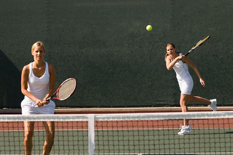 two women playing tennis