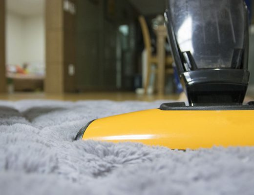 vacuum cleaner on grey carpet