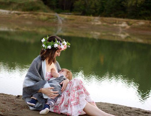 woman breastfeeding in nature