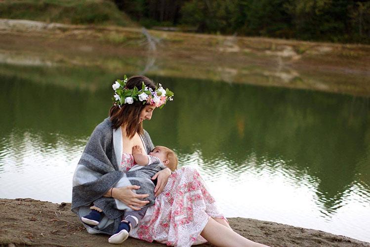 woman breastfeeding in nature