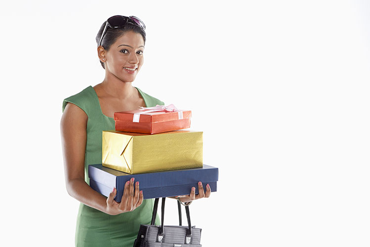 woman carrying gift boxes