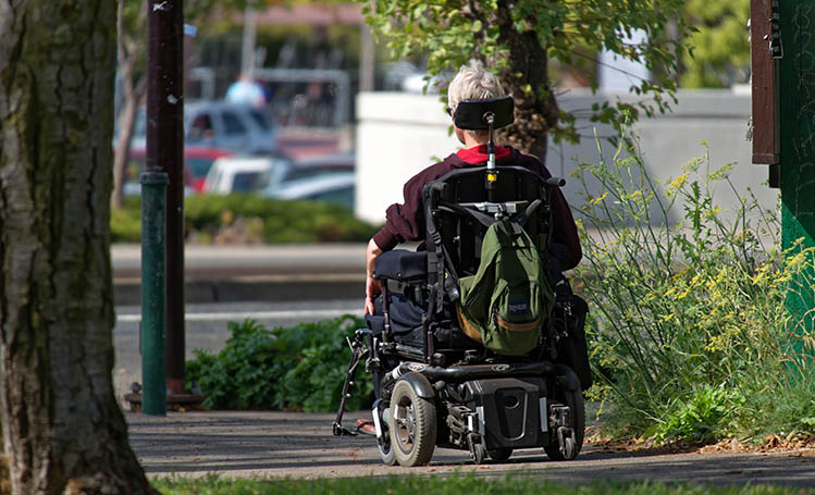 woman in motorized wheelchair