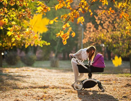 woman in park with baby stroller