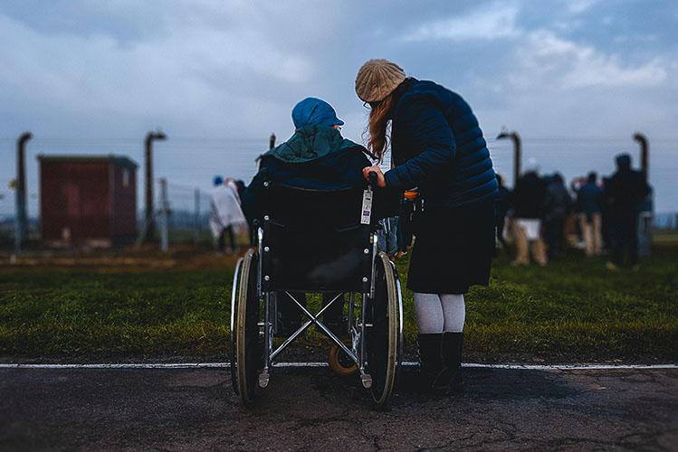 woman near person in wheelchair