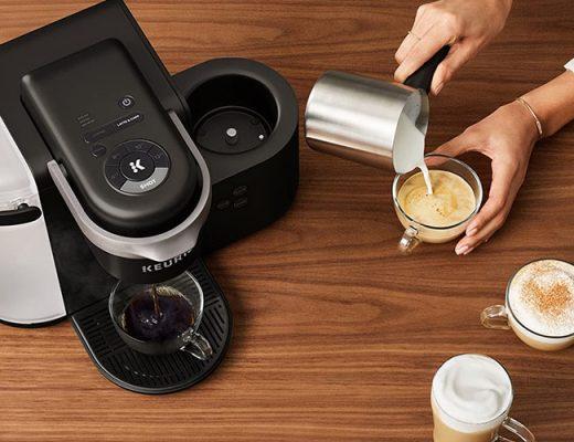 woman preparing cappuccino