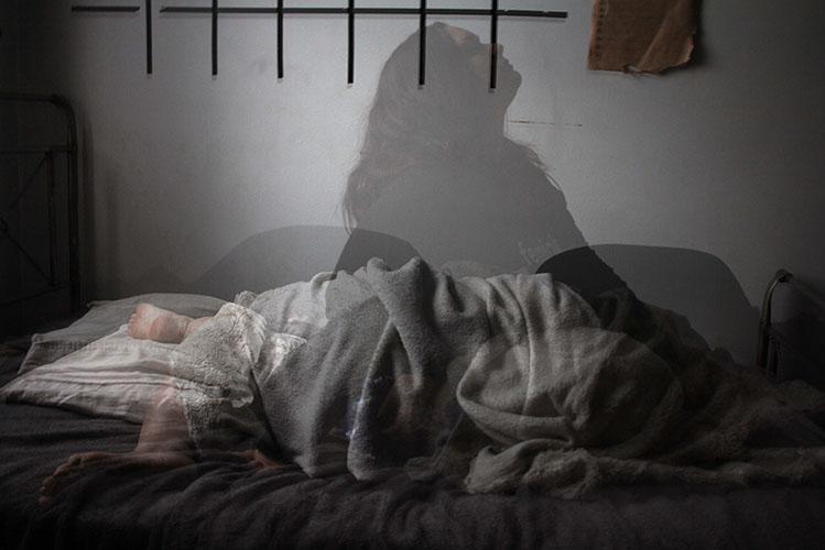 woman sleeping shadow insomnia