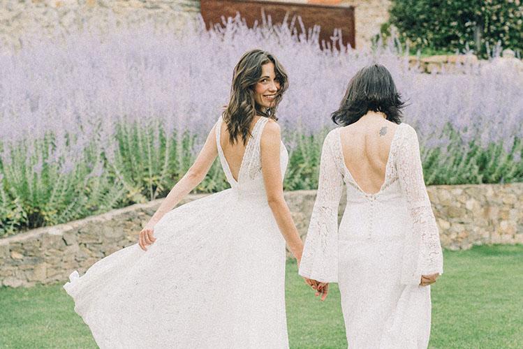 women in white wedding dress walking on grass