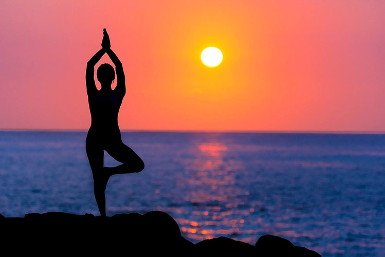 yoga silhouette sun sea