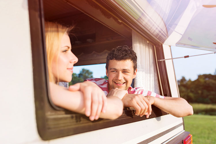 young couple in a camper van