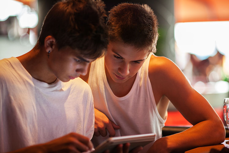 young men using tablet