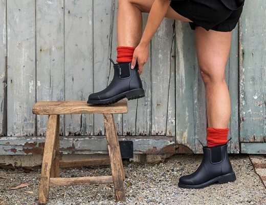 young woman checking her rubber boots
