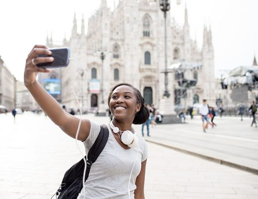 young woman taking selfie in milan